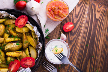 Roasted potatoes with herbs and tomatoes