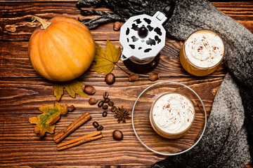 pumpkin spice latte with whipped cream and pumpkin, top view