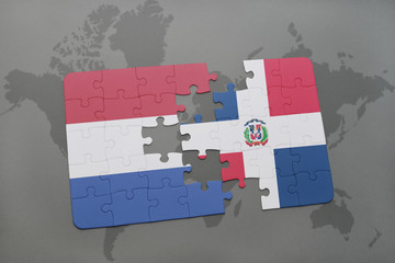 puzzle with the national flag of netherlands and dominican republic on a world map background.