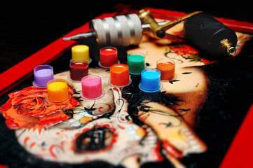colored tattoo ink in the caps for tattoo ink on a gold background tattoo machine