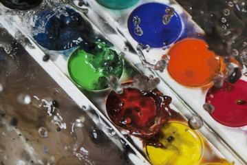 photo of water splash and color paints