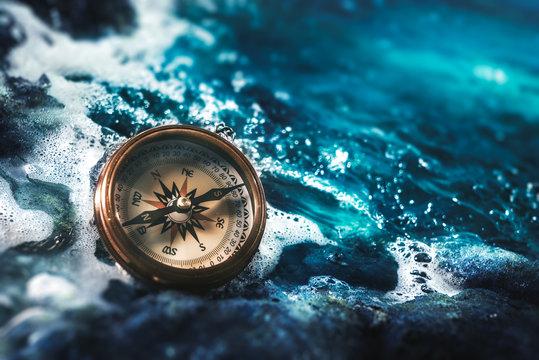 compass on rocks with a dark sky