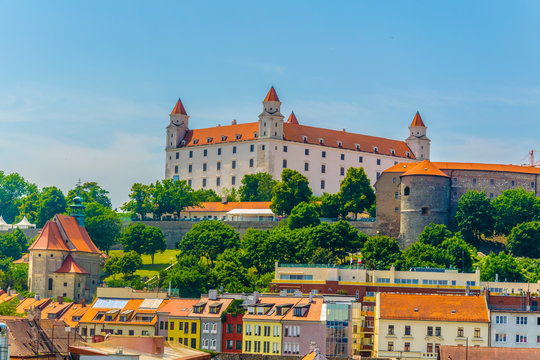 view of the bratislava castle situated on a hill next to the danube river in slovakia