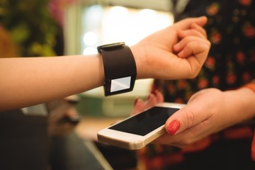 Hand making payment through smartwatch