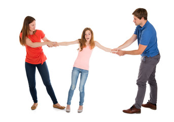 Unhappy Couple Pulling Their Daughter On Their Side