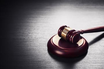 judge gavel on a black  wooden background