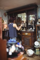 Rear view of woman shopping for antiques