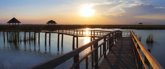Beautiful panorama scenery of wood bridge during time the sunset and the beautiful colorful sky at Khao Sam Roi Yot National Park in Thailand is a very popular for photographers and tourists