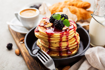 Pile of pancakes with fresh berries