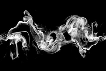 smoke swirls on black background.