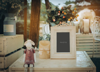 vintage blank frame on table in wedding day with vintage filter