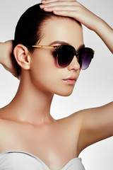 Beautiful young model with big sunglasses. Fashion makeup