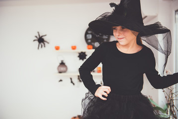 Girl in Witch costume smiling