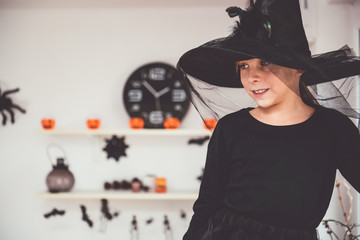 Girl in Witch costume looking down