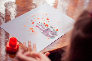 Paintings with children hand