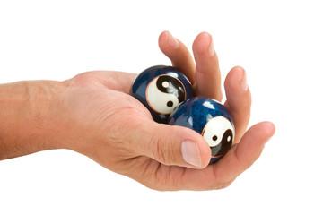 hand holds a ball