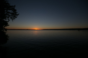 Sunset on a calm lake in Ontario Canada