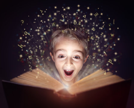 Child reading a magic story book