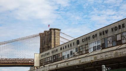 Old Fulton Fish Market with Brooklyn Bridge City of New York