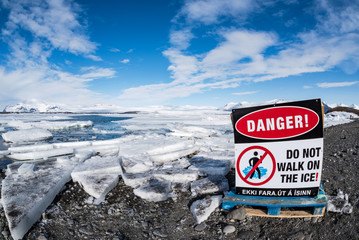 danger sign at Jokulsarlon Glacier Lagoon at wintertime, iceland