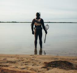 Spear fisherman standing in water