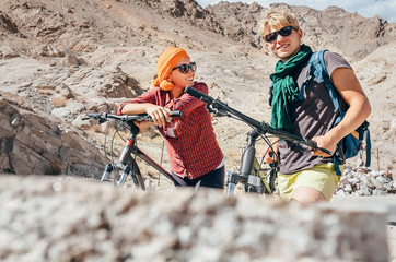 Two cyclists traveler are in mountain