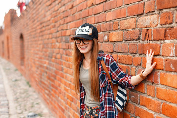 Beautiful cheerful girl hipster smiling in shirt with glasses