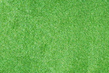Top view of artificial green grass for texture and background.