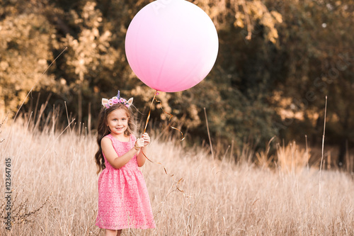 Stylish Baby Girl 4 5 Year Old Holding Big Balloon Wearing Trendy Pink Dress In