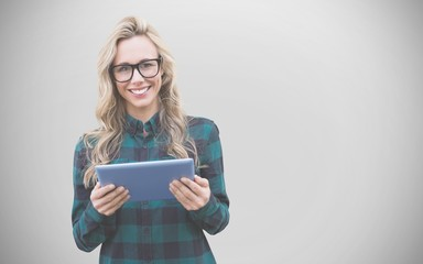 Composite image of pretty blonde with tablet