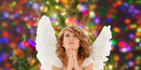 praying teenage angel girl or young woman