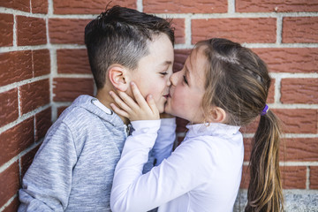 First love and kiss two happy cute kids meeting