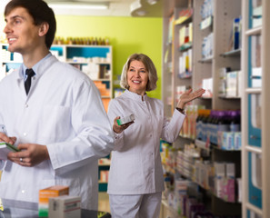 Portrait of two caring pharmacists