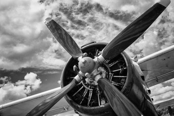 Close up of old airplane in black and white