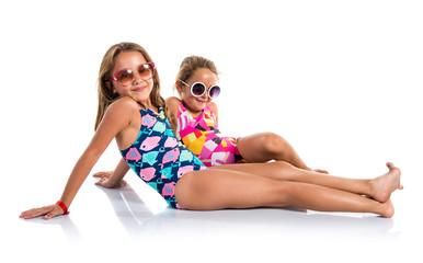 Little cute girls in swimwear