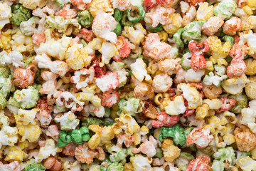 Colored Popcorn texture background. Sweet popcorn.