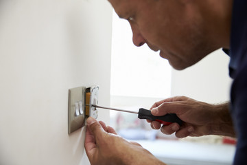 Electrician Repairing Domestic Light Switch