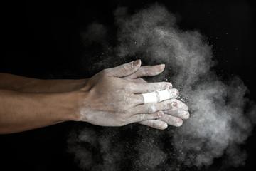 Climber hands get a chalk coating
