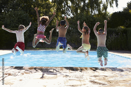 Rear View Of Children Jumping Into Outdoor Swimming Pool Stock Photo And Royalty Free Images
