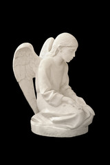 Statue of child angel. Isolated on black background