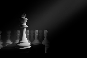 3D Rendering : illustration of chess pieces.the king chess at the center with pawn chess in the back. chess board.light drop at the king.leader concept.success business leader concept