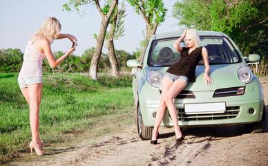Girls shooting near a car