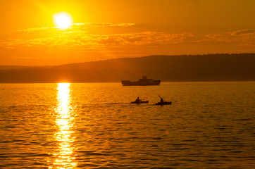 Kayakers and Ferry on Lake Superior at Sunset