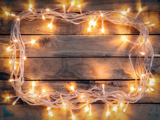 Christmas decoration background - vintage planked wood with ligh