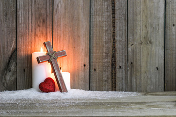 White candles, wood cross and red heart