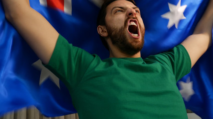 Fan celebrating and holding the flag of Australia