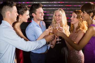Group of friends toasting glasses of champagne