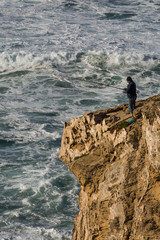 angler at a cliff and rock