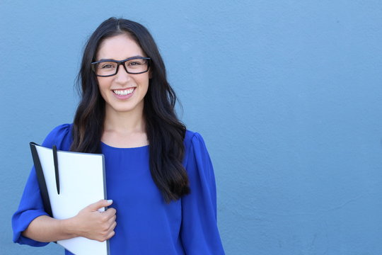 Stock image of female college student isolated on blue background