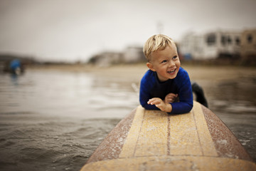 Little boy on surfboard